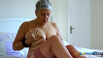 Busty mature lady seductive solo action video
