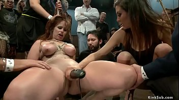 Brunette domme Princess Donna Dolore with dick on a stick in her hands fucks bound natural busty redhead slave Bella Rossi in public d.