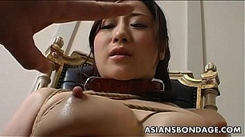 Bondage with dildo vibrator touching pussy