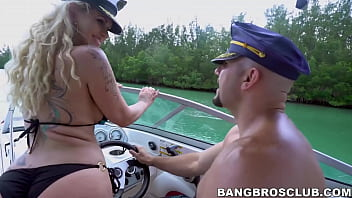 Inked MILF hammered by big dick on boat