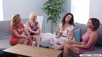 Four busty milfs are in the living room playing card games.After playing,they decide to swap their wives.The two milfs go into the room and start kissing each other.Next is they lick their wet pussies before they switch to 69 position.