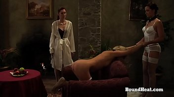 Young Blonde Lesbian Slave Undressed, Bent Over and Ass Whipped By Her Dominant Mistress