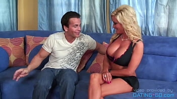 Busty blonde bimbo takes off her clothes