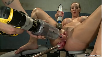 Fake huge boobs brunette slut Kelly Divine is anal fisted and fucked with different sex toys then double penetration machine banged