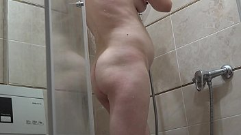 The mom in the early pregnancy is washed in the shower. Homemade fetish with overgrown cunt.