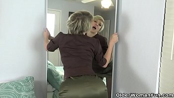 Big titted milf Dee Williams from the USA wears a crotchless pair of pantyhose and admires her wet pussy in the mirror