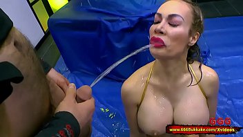 Beautiful slut with big tits Chessie Kay gets in the piss arena for some serious fucking and fetish watersports! 666Bukkake
