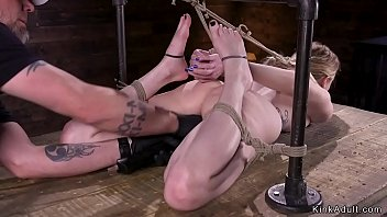 Sexy blonde slave in chair rope bondage gets tormented then pussy fingered laid on stomach