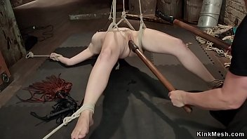Sexy blonde slave tied up spreaded on the floor fucked with dick on a stick