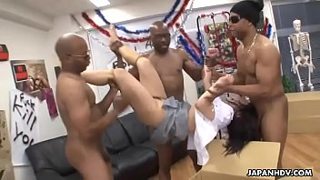 Asian babe in a box getting fucked by black dudes
