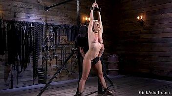 Hot blonde slut in standing bondage anal finger fucked