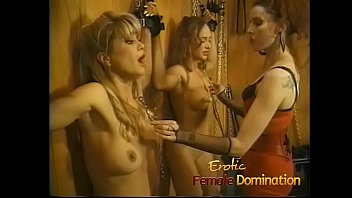 Two really hot slave girls scream when the mistress squeezes their boobs.