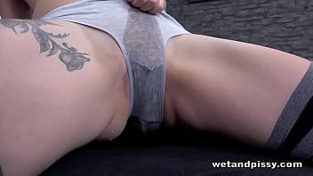 Kate Fresh pees through her cotton panties and strips to taste her juices before panty stuffing her shaved pussy and toys herself, finishing her solo play with her fingers