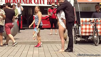 Petite Euro brunette babe Juliette March made by her master Steve Holmes walking with gag ashtray and exposing pussy to evryone in public