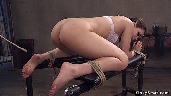 Nasty hot brunette slave in doggy bondage gets caned