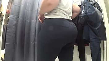 A hidden camera peeps for the fat booty in the fitting room. The chubby beauty takes off her tight jeans and changes clothes.