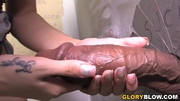 Big black cock slut Megan Foxx gives interracial blowjob at a public restroom.