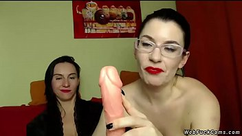 Two Brunette Milf Lesbian Bffs One Of Them With Eyeglasses Posing On Cam In Private Webcam Show Then Playing With Long Dildo For Their Users thumbnail