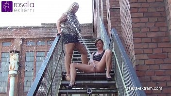 Two horny girls peeing outdoor extreme, in front of spectators!