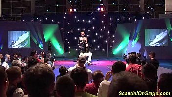 big boob bdsm milf enjoys a real extreme needle fetish show on public sexfair show stage