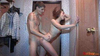 Young brunette teen fucks in a hallway