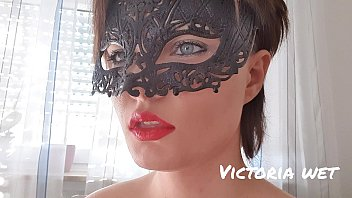 masked beautiful girl and fetish smoking a cigarette