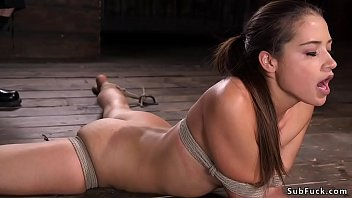 Gagged and tied up beauty gets pussy vibrated then siffers hogtie suspension