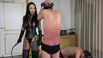 The mistress whips and bites two men