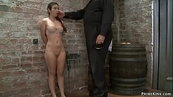Gagged busty brunette slave Serena Blair with hands in box tie gets caned and made walking on crotch rope by rough master Sgt Major on hogtie