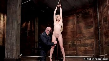 Gagged with tights blonde slave Emma Haize gets crotch rope bondage and shaved pussy vibration then nipples clamp from masked master in dungeon
