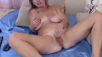 Mature slut with saggy tits masturbating on webcam