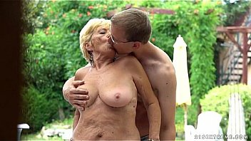 Young nerdy guy fucking blonde granny at pool