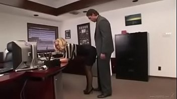 Blonde secretary in stockings and glasses
