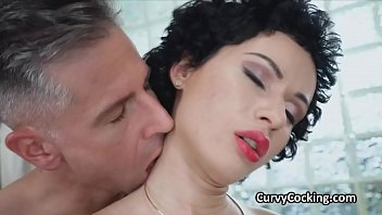 Curly busty hottie with short hair oiled and drilled