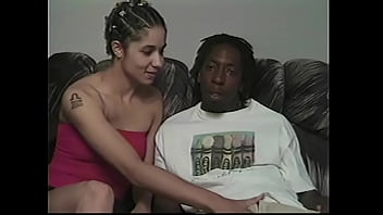 A big black guy with a huge dick fucks a naughty young chick with elastic tits in all positions