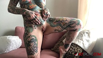 Horny brunette covered in tattoos masturbates while on covid lockdown