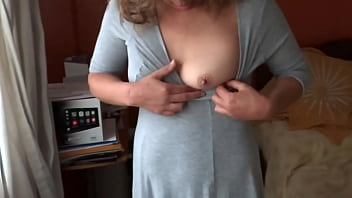 My 58-year-old aunt in her bedroom gets dressed to go to a party, she observes that her nephew is spying on her and that turns her on, she masturbates intensely and has several orgasms, while she watches him jerk off and cum on her thongs