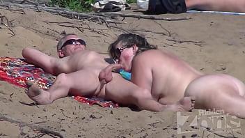 Blowjob on nudist beach