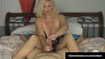big tits | Want your cock serviced by a horny milf in your bed? the beautiful charlee chase shows off her huge tits as she wraps her expert hands around your hard shaft to make you cum for her! Thumbnail