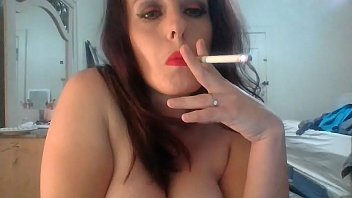 Get your Jollies off watching Goddess Ruby smoke topless