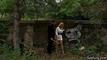 Master Steve Holmes caning big ass blonde slave Isabella Clarkin in public park