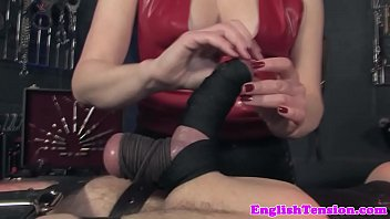 Flogging bdsm mistress in closeup cbt action