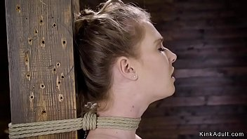 Brunette slave is strated in side bondage suspension then with crotch rope and bowling ball running through cunt