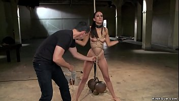 Rope tied slim brunette slave trainee Lyla Storm standing with legs spreaded and with vibrator on her pussy and getting bowling balls hung to waist by master James Mogul and fucked by gimp Owen Gray