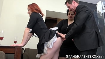 Redhead maid pounded by mature couple
