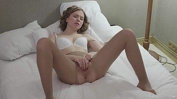 Ksenija A wearing a bra and nude colored pantyhose