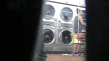 I flash upskirt in front of a young man at the laundry because Im an exhibitionist and love exposing herself to a voyeur Pt 2