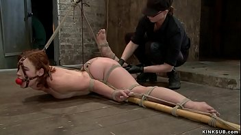 Beautiful tied redhead lesbian slut Jodi Taylor in clotheswhile sitting is made to fuck vibrator then laid on the floor is fingered by lezdom Claire Adams