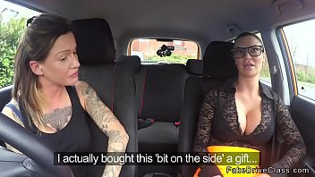 Alt brunette driving student gets big strap on from busty examiner