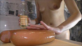 Horny blonde used a sausage as a dildo for masturbation